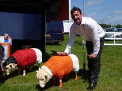 One of Blackpool FC bosses with premier Sheep